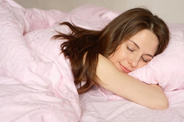 woman-happy-sleeping-pink-bed